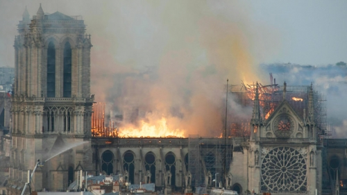 Flames rise from Notre Dame cathedral as it burns on Monday, April 15.