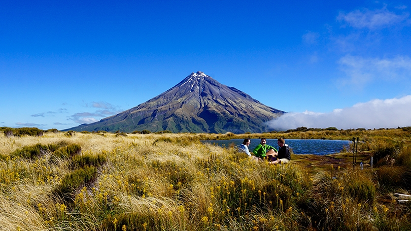 students sitting at the base of a volcano in New Zealand